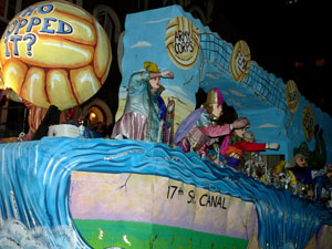 "Krewe D'etat float, ""Who Dropped It"" on a giant basketball with 17th St. Canal overflowing"